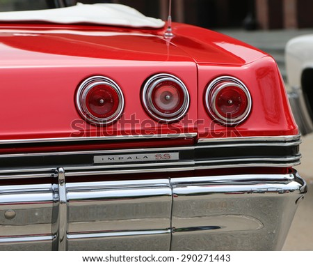 FLINT, MICHIGAN-JUNE, 2015:  Taillights from a 1965 Chevrolet Impala SS convertible. - stock photo