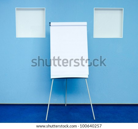 flip chart in conference room at hotel ready for business training - stock photo