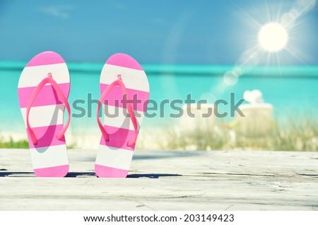 Flip-flops against ocean. Exuma, Bahamas - stock photo