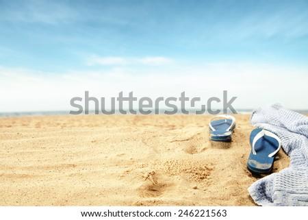 flip flops and towel  - stock photo