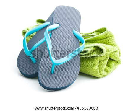 Flip flops and towel isolated on white background. - stock photo