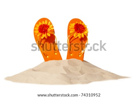 flip-flops on a sunny pile of sand - stock photo