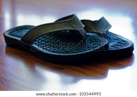 Flip Flops on Hardwood Floor - stock photo
