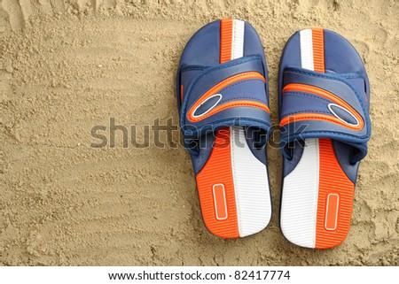 Flip flops on sand - stock photo