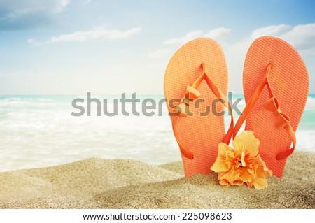 flip-flops on sand beach - stock photo