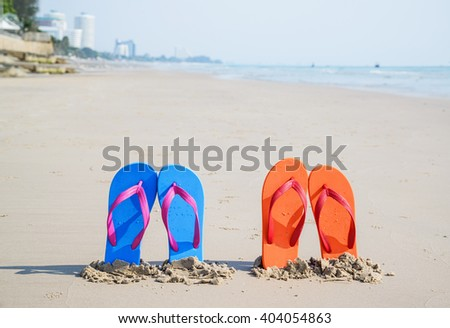 Flip-flops on the beach, on tropical sand. Summer vacation concept. - stock photo