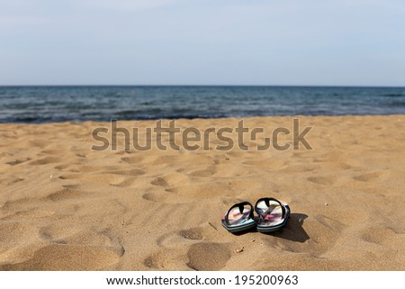 Flip Flops on the Beach Sand - stock photo