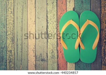 Flip-flops on vintage wood.Summer holiday background concept.Copy space.Vintage tone. - stock photo