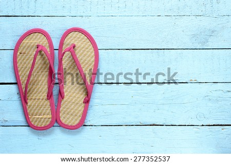 Flip-flops shoes on wooden background - stock photo