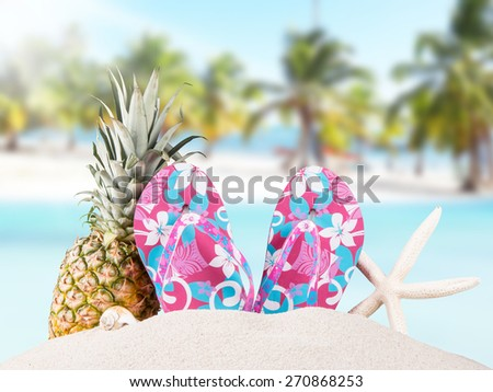flip-flops with tropical beach background, summer accessories - stock photo