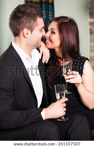 flirting couple at a party - stock photo