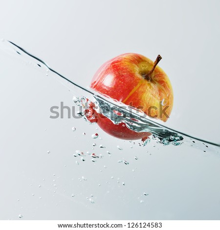 Floating apple - stock photo