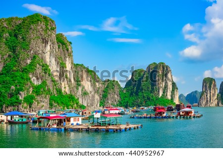 Floating fishing village and rock islands in Halong Bay, Vietnam, Southeast Asia. UNESCO World Heritage Site. - stock photo