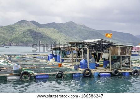 Floating fishing village, near Nha Trang, Vietnam - stock photo