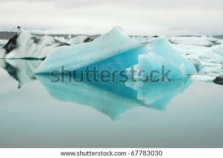 Floating iceberg in Jokulsarlon ice lagoon in Iceland. - stock photo
