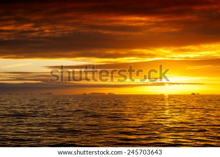 Floating iceberg in the ocean at sunset. Antarctica, southern ocean. - stock photo