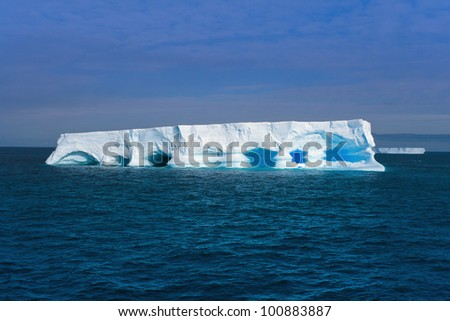 Floating iceberg near King George Island, Antarctic Peninsula - stock photo