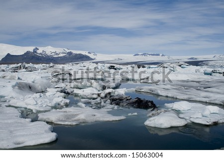 Floating icebergs at the Glacier Lagoon - stock photo