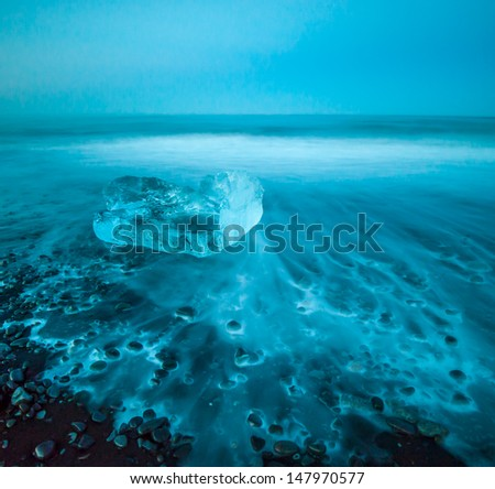 Floating icebergs in Jokulsarlon Glacier Lagoon, Iceland - stock photo