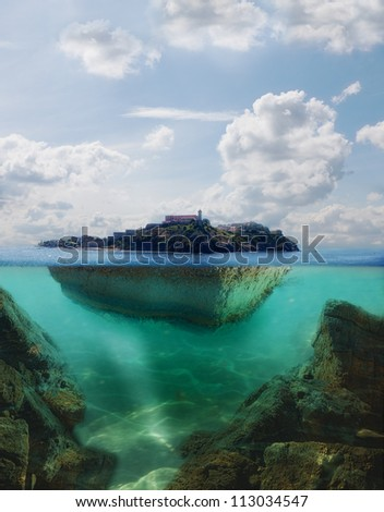 floating island with lighthouse on it - stock photo