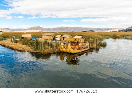 Floating Islands on Lake Titicaca Puno, Peru, South America, thatched home. Dense root that plants Khili interweave form natural layer about one to two meters thick that support islands - stock photo