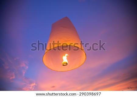 Floating lanterns in the evening sky at Thailand - stock photo