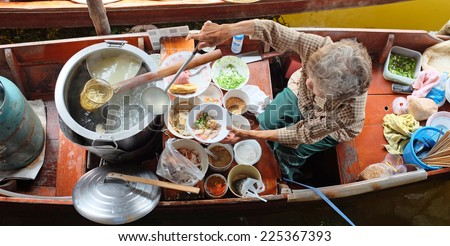 Floating market in Thailand selling paste of noodle - stock photo