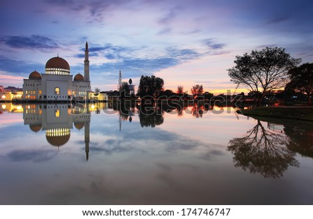 Floating mosque at Dawn with reflection - stock photo