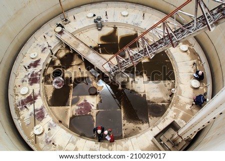 Floating roof tanks, oil storage, renewable energy. - stock photo