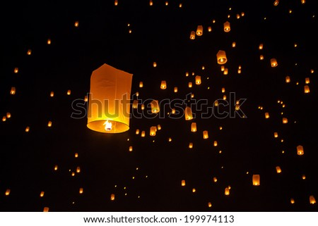 Floating sky lanterns during Yi Peng Festival in Chiang Mai, Thailand - stock photo