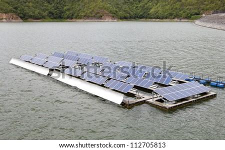 Floating Solar Energy Panels on a lake - stock photo