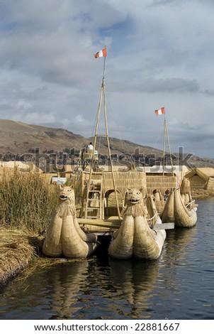 Floating Uros Island boats on Lake Titicaca in Peru - stock photo