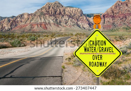 Flood Area Warning Sign:  A sign in southern Nevada warns of a flash flood area ahead.  - stock photo