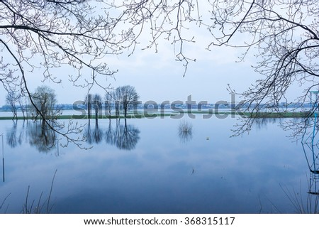 Flood at the local river made some disaster for the locals. View to the village. - stock photo