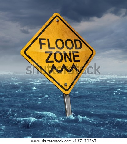 Flood warning concept with a yellow traffic sign flooded with water on