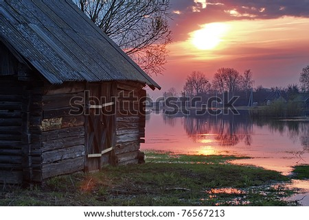 Flooded boarded-up homes during the spring flood of the Pripyat River - stock photo