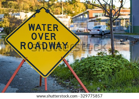 Flooding Disaster Water Over Roadway Flooded Parking Lot - stock photo