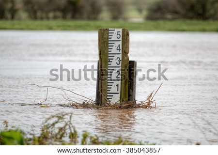 Flooding River. High Water Level Marker Gauge - stock photo
