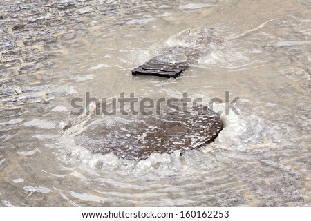 Flooding, sewer clogged after heavy rains in Spain - stock photo