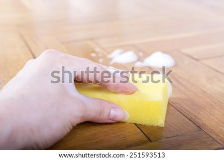 Floor cleaning, sponge with foam - stock photo