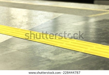 Floor of the subway station - guide track for the visually impaired - stock photo