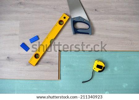 Floor panels, parquet, laminate, wood flooring and tools. - stock photo