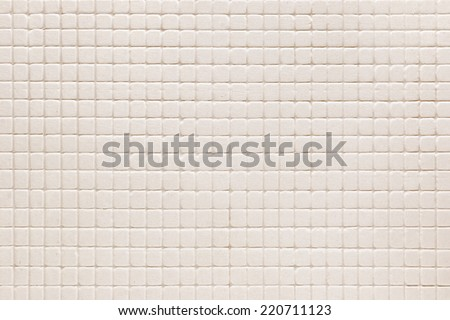 Floor tiles of the same pattern used for the background. - stock photo