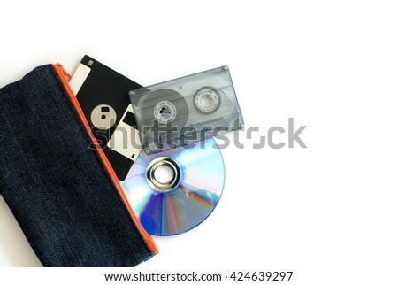 floppy disk, audio tape cassette and compact disc in bag isolated on white background - stock photo