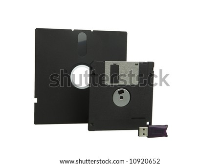 floppy disks and usb flash drive on white - stock photo