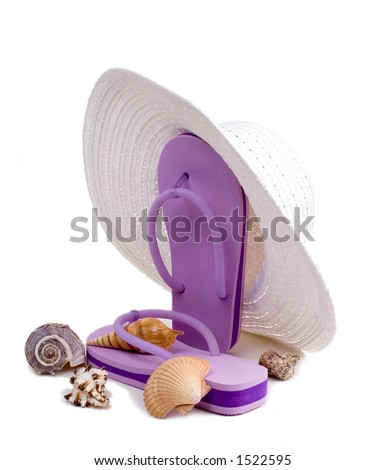 Floppy white sun hat, flip flops, and seashells isolated on a white background.  A day at the beach. - stock photo
