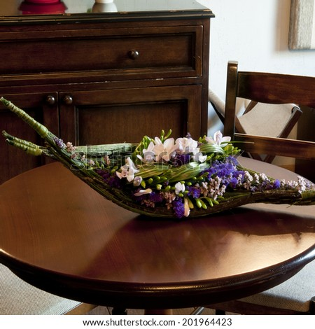 Floral arrangements for a banquet in a restaurant. - stock photo