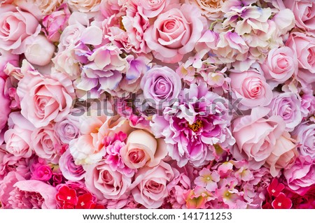 Floral background. Lot of artificial flowers in colorful composition - stock photo