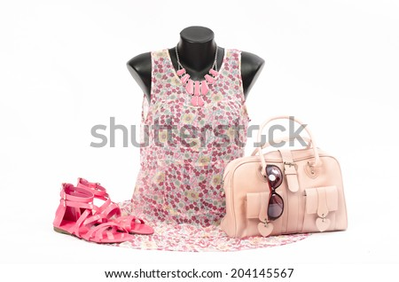 Floral blouse on mannequin with matching accessories. Pink blouse on tailor's dummy with matching purse,sandals and necklace. - stock photo