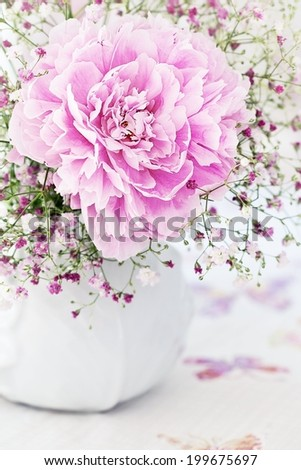 floral composition with a peony flower on a light background - stock photo